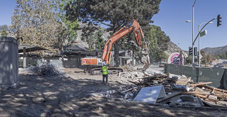 Bulldozers demolish the façade of the Festival of Arts. Next week at the annual meeting, Festival members learn the details of the exterior facelift, the results of the summer season and the next production theme for the Pageant of the Masters. Photo by Mitch Ridder