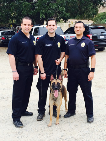 Lt. New canine handler Officer Zach Fillers, center, with Lt. Jeff Calvert, left, and Sgt. Eric Lee and Ranger.