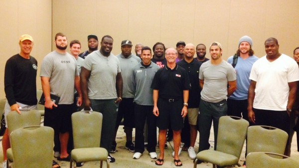 Robert Owens, center, met  with the New York Jets early in this year's football season for a motivational session.
