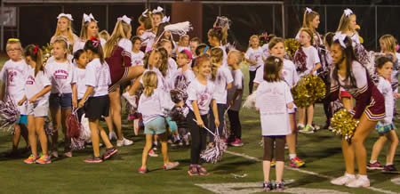 Wanna-be cheerleaders, who participated in a cheer workshop, performed at half time with the LBHS cheer squad.