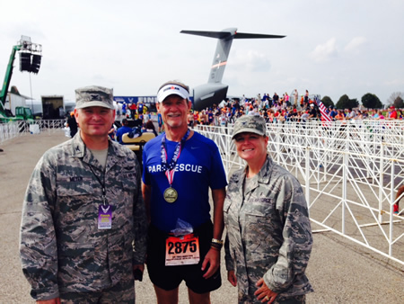 Two colonels stop Robert Owens after he crossed the finish line of a marathon in Dayton, Ohio, in October.
