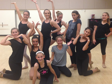 """Laguna's own Sabrina Harper, performing in """"Pippin"""" at the Segerstrom Center, conducts a master class at Kyne Dance Academy, where she danced as a young girl. Her students: from left, standing, Madeline Wolfson, Sabrina Harper, Hannah Connely, Kailee Deitz, Eayston Cianto; middle, Charlie Hutson, Emma Sarkissian, Phoebe Radisay, Hannah Abrahamson; front, Shelby Wolff."""