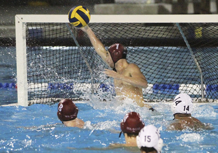 Senior Garrett Hartley swats away one of his 12 saves during Laguna's CIF finals win over Montebello . Photo by Dante Fornaro