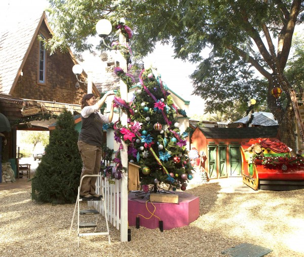 Jamie Bichler adds a decorative touch to the Sawdust Winter Festival Towne Square, opening Saturday, Nov. 23.