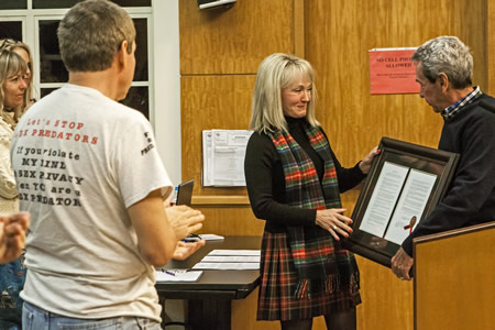 Elizabeth Pearson receives a warm send-off after 12 years on the City Council from Council member Kelly Boyd.