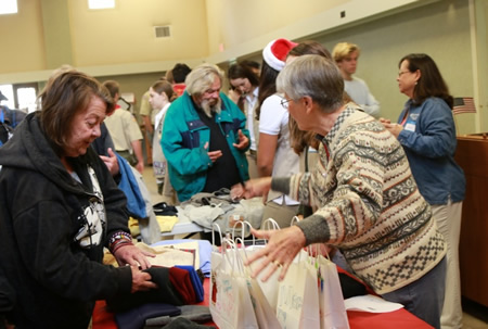 With the help of a scout troop as food servers, Laguna Presbyterian Church hosted a hot breakfast for those who are without homes this past weekend. Guests also took away goodie bags, hats and scarves. Photos by Faye Chapman.