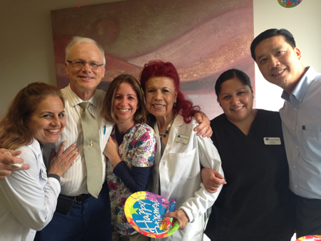 Dr. Korey Jorgensen, second from left, receives well-wishes from Adriana Nieto Sayegh, Nicole Sicotte, Mary Nieto, Alma Tellez and Dr. Chau Ngo on his retirement from the Laguna Beach Community Clinic last week. Jorgensen, an HIV specialist, served as the clinic's medical director but in recent years has volunteered part-time. Photo curtesy of Laguna Beach Community clinic.