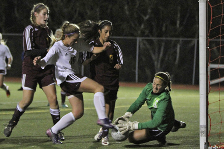 Paige Vitolo arrives too late to get the ball past the Ocean View goalie.