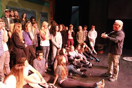 Teacher Mark Dressler directs student actors in the recent production.