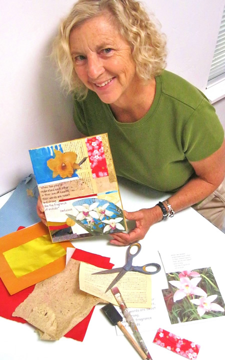 Instructor Hedy Buzan shows a finished work. Photo by Mike Tauber.