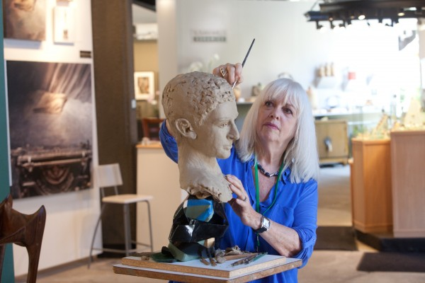 Sculptor Elaine Cohen demonstrates her technique at the Festival of Arts.  Analysis of the town's cultural assets is expected to yield an arts master plan by 2016.