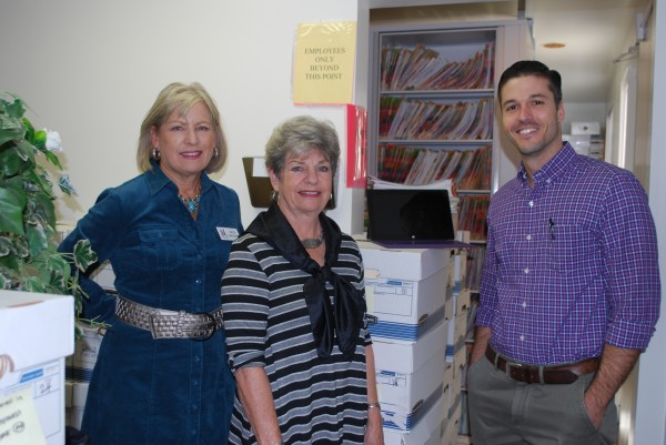 Assistance League officers Gayle Whitaker, left, and Judy Soulakis get a first-hand  look at the records conversion progress from Dr. Jorge Rubal, the clinic's assistant medical director