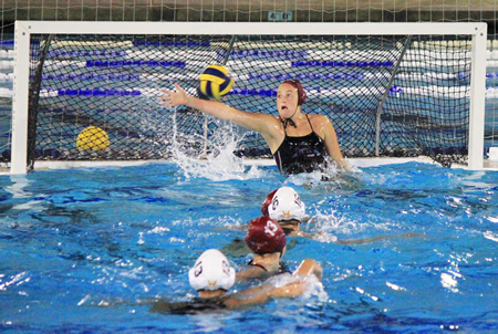 :  Holly Parker reaches for one of her 13 saves against Foothill in the Finals of the Holiday Classic at Newport Harbor High on Saturday, Jan 3.