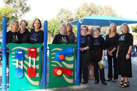 Front, from left, at the music wall: League members Ann Hyde, Lynne Vihlene, Elaine Merz, Karen Mauro, Diane Gelfer, Judy Soulakis and Gayle Whitaker; back, Sharla Pitzen, executive director for special education; Judy Dore, ENF principal; and Amy Hanacek, Capistrano Unified District trustee.
