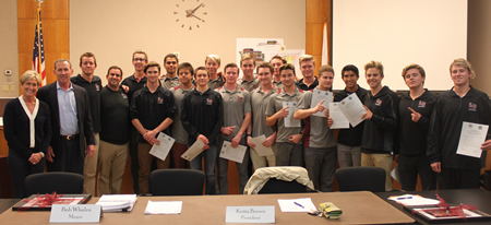 School Board President Ketta Brown, far left, and Mayor Bob Whalen, second from left, congratulated the high school water polo team on its Division 3 championship last week.