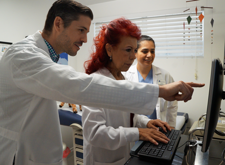 Community clinic staff, from left, Dr. Jorge Rubal, Mary Nieto and Nancy Sandoval now use an electronic medical records system.