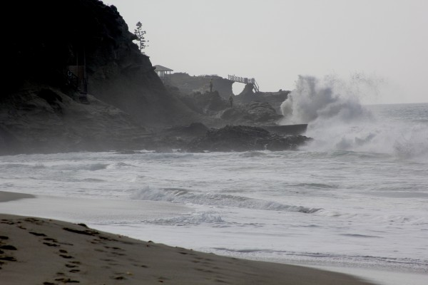 Guards search the southern cave on Thousand Steps Beach for a missing man as waves intensified Monday. Photo by Andrea Adelson.
