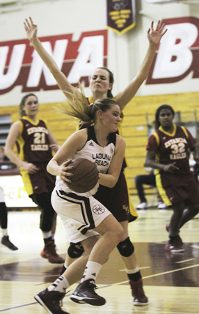 Junior Sydney DeCarlo works to get an open down low against Estancia at home on Tuesday, Feb. 3. Photo by Dante Fornaro