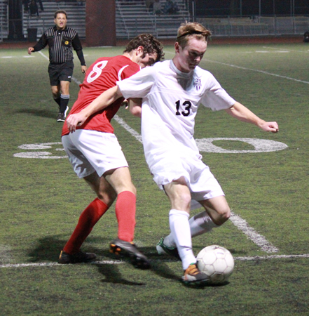 Senior Tobie Grierson alludes an Estancia defender during Laguna's 1-0 victory on Guyer Field Friday, Feb 6.