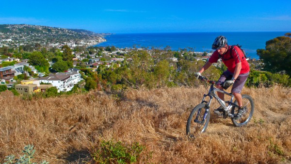 Mountain biker Pat Freeman rides in Crystal Cove State Park overlooking Irvine Cove.Photo by Freeman Images