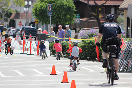 Turnout was greater than expected for Sunday's  police department-sponsored bike rodeo, which involved stunt riders and safety demonstrations. A mix of children, adults, and active cyclists attended, said police Sgt. Tim Kleiser, and several members of the Laguna police force, including Officer Darin Germaine, participated. Photo courtesy of the LB Police Department.
