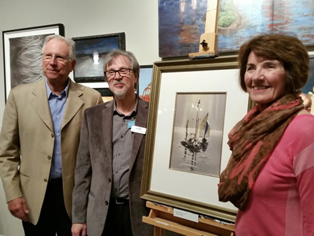 LCAD President Jonathan Burke with the Rex Brandt painting donated to the college by collectors Mark and Jan Hilbert.