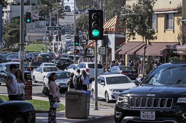 Summer-like weather has city officials pressing for more measures to curb congestion.
