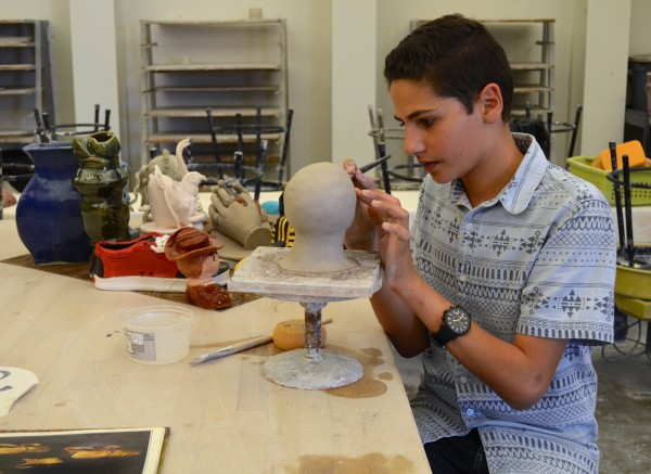Ceramics student John Gerges, whose work will be  exhibited at the LB –AP–Clay show at the Coastal Eddy gallery