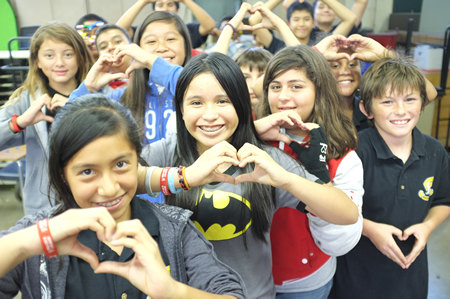 Kids from the Anaheim Family YMCA show their love for iheartoc Giving Day.
