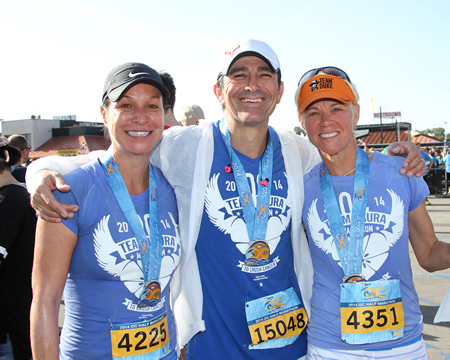 Debra Hayburn, left, is joined by Edward Gonzalez and Patsy Howser at last year's OC Half Marathon.