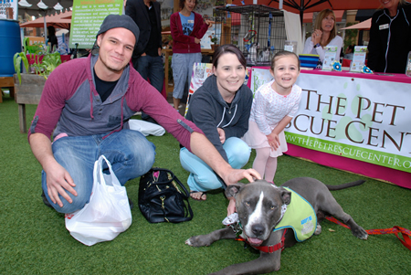 Lake Forest residents Ryan Schlax, Caitlyn Divino and Kadyn Schlax discover  Jagger, a Pet Rescue Center client, at a fundraising rally at the Irvine Spectrum last week. Laguna nonprofits benefited from the effort.