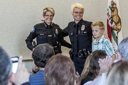 Laguna Beach police Chief Laura Farinella, left, with her wife, Dawn Collinske and son, at her  community badge pinning ceremony.  Photo by Mitch Ridder.
