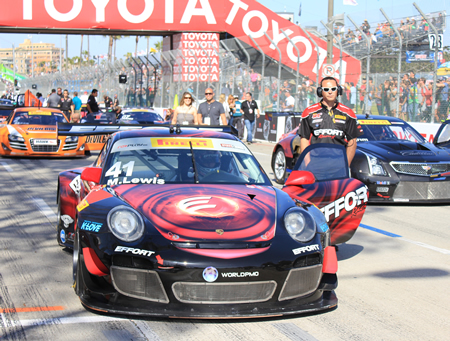 Michael Lewis in his #41 Porsche 911 GT3 waits on Shoreline Drive in Long Beach for the start of the Pirelli World Challenge.Photo Credit: Robert Campbell