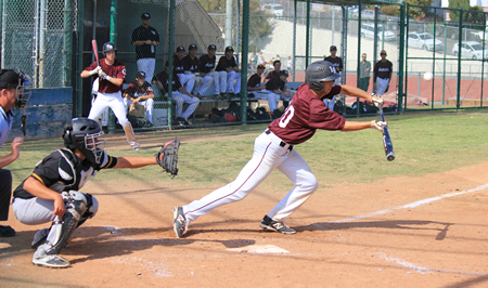 Anthony Norelli lays down a bunt single against Godinez at Skipper Carrillo Field on Thursday, April 2. Laguna won the game 16-0. Photos by Robert Campbell.