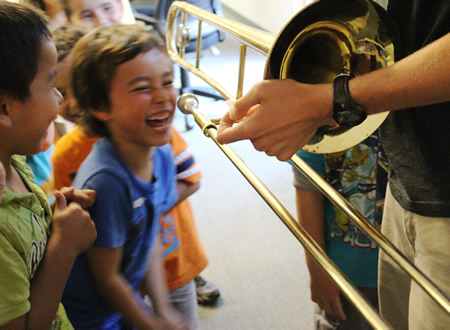 Kids try out instruments through Laguna Beach Live's outreach program.