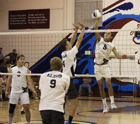 Pete Obradovich goes up for one of his 19 kills against Aliso Niguel in Laguna's 3-1 CIF quarterfinals win at Duggar Gym. Photo by Robert Campbell.