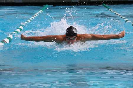 Erik Juliusson, a junior,  swimming the 100 Fly in the Orange Coast League Finals last Friday at Costa Mesa High School., Erik set the new meet record at 49.72 and was key in Laguna capturing their seventh straight league crown   photo courtesy of Dave Nash.