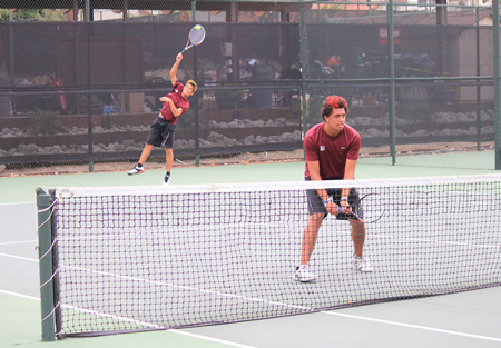 Ryan Gee (serving) and Hayden Seitz won two of Laguna's six matches in the team's 12-6 CIF finals loss to Redlands on Friday, May 22, at Claremont Tennis Club. Photo by Robert Campbell.