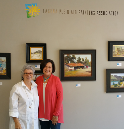 Rosemary Swimm, left, and Toni Kellenberg visit the first LPAPA exhibition at the Forest & Ocean Gallery.