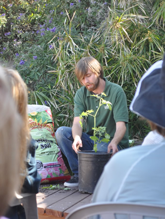 Dylan Hamburger explains all things tomato at a garden workshop.