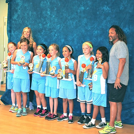 The Final: From left, champion basketball players Mila Davis, Sophie Colladay, Bella Rodas, Ayla Keller, Julie Silva, Sydney Ford and Lea Garcia finished their season 9-0 at the Boys and Girls Club this past Saturday, June 6. With them are coaches Kat Davis and Ken Garcia. Not present, Coach Tayber Garcia.