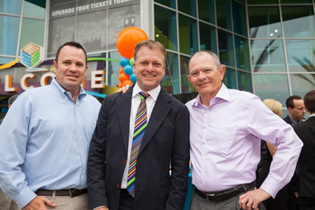 Locals Steve and Jim Muzzy flank Joe Adams at the grand re-opening of the expanded Discovery Cube earlier this month.