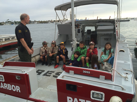 Scout Pak 35 Webelos toured O.C. Harbor Patrol's  offices and rescue boat in Corona del Mar to learn about harbor safety. Officers shot off a water cannon for the visitors.