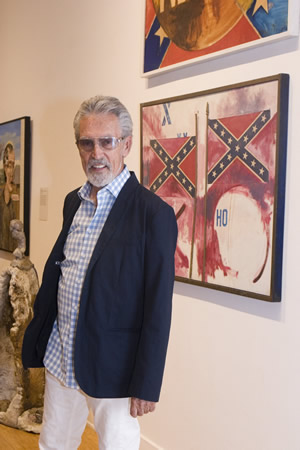 G. Ray Kerciu with his work at the Laguna Art Museum.
