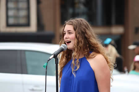 Tessa Mansour, who will sing at a major league baseball game, performed at Main Beach  on Memorial Day. Photo courtesty of Laguna Concert Band.