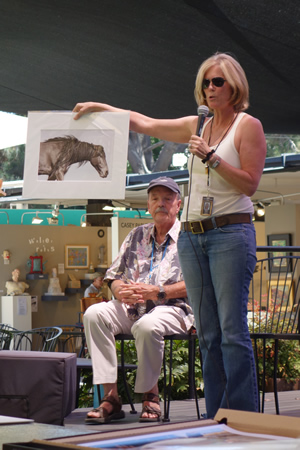 Nancy Holly describes capturing images of horses during one of last year's Art Talks.