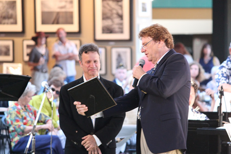 Mayor Pro Tem Steve Dicterow serves as guest conductor earlier this summer and receives a proclamation from band director Ed Peterson.