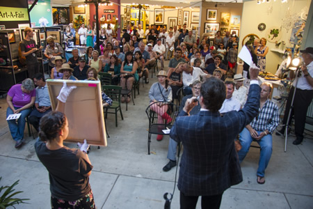 Auctioneer Mark Thomas at work on the Art-a-Fair grounds earlier this month.