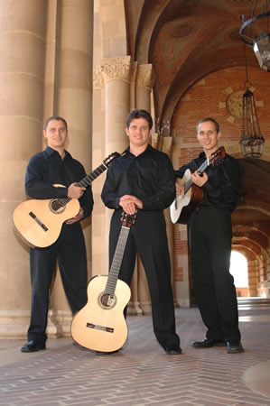 A guitar ensemble performs next week in a museum gallery.