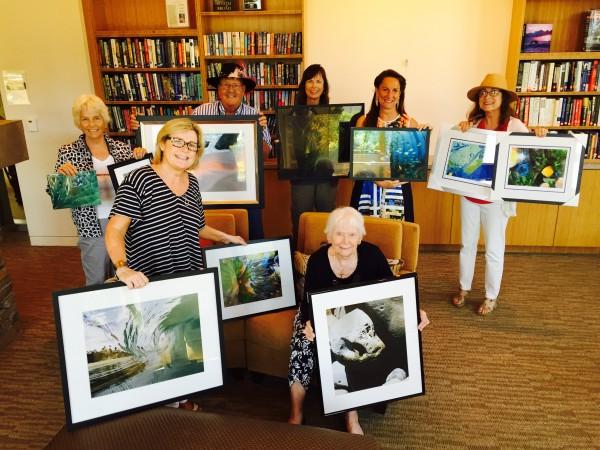 From left, Charlotte Masarik, David Linnig, Jinger Wallace, Judy Baker, Lauren Panno, Gallery Q Art Director Mary Ann Schierholt and Jean Drake show off their favorite sea-inspired photos.